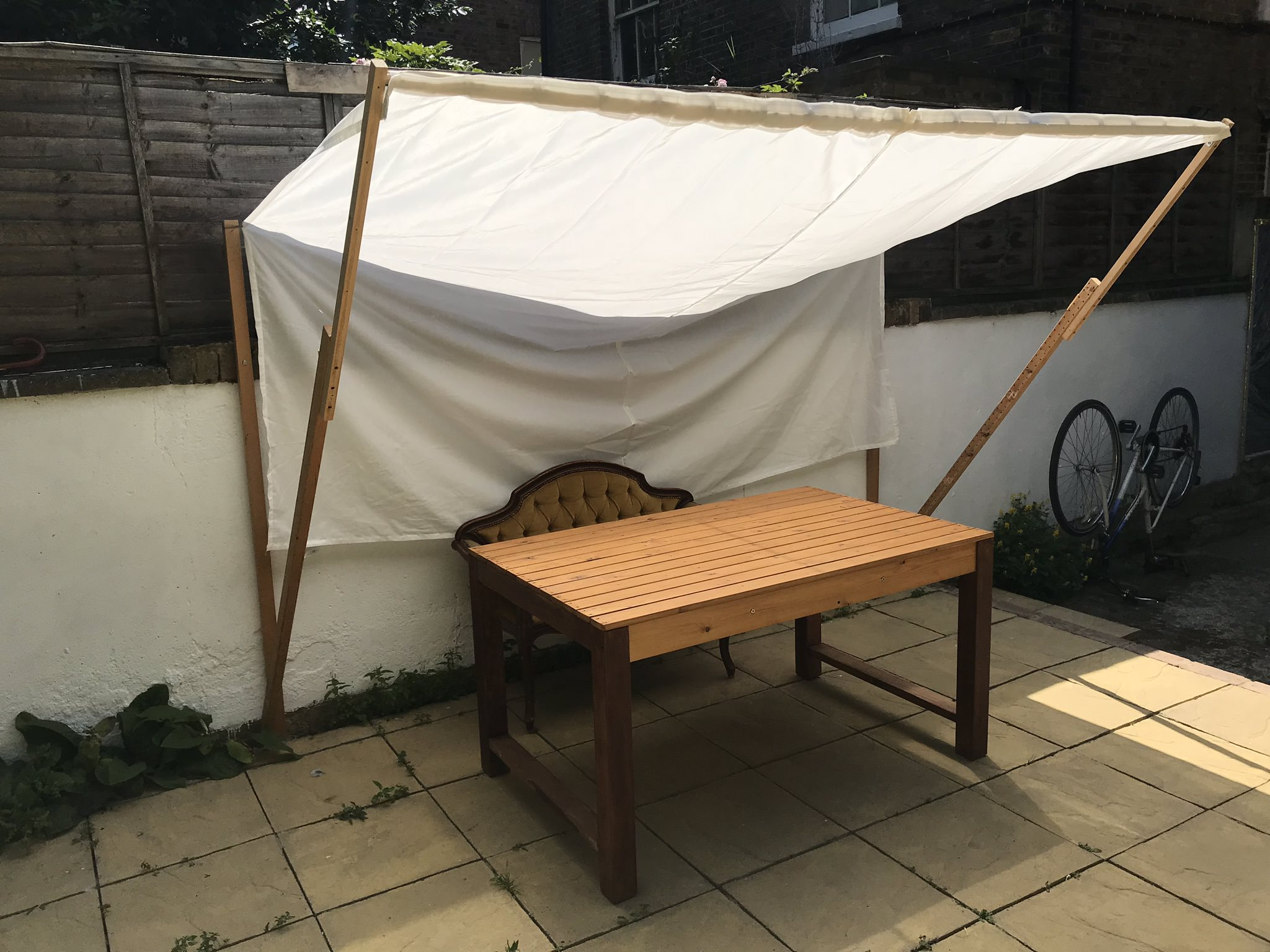 Pergola in assembled and open state creating a shade