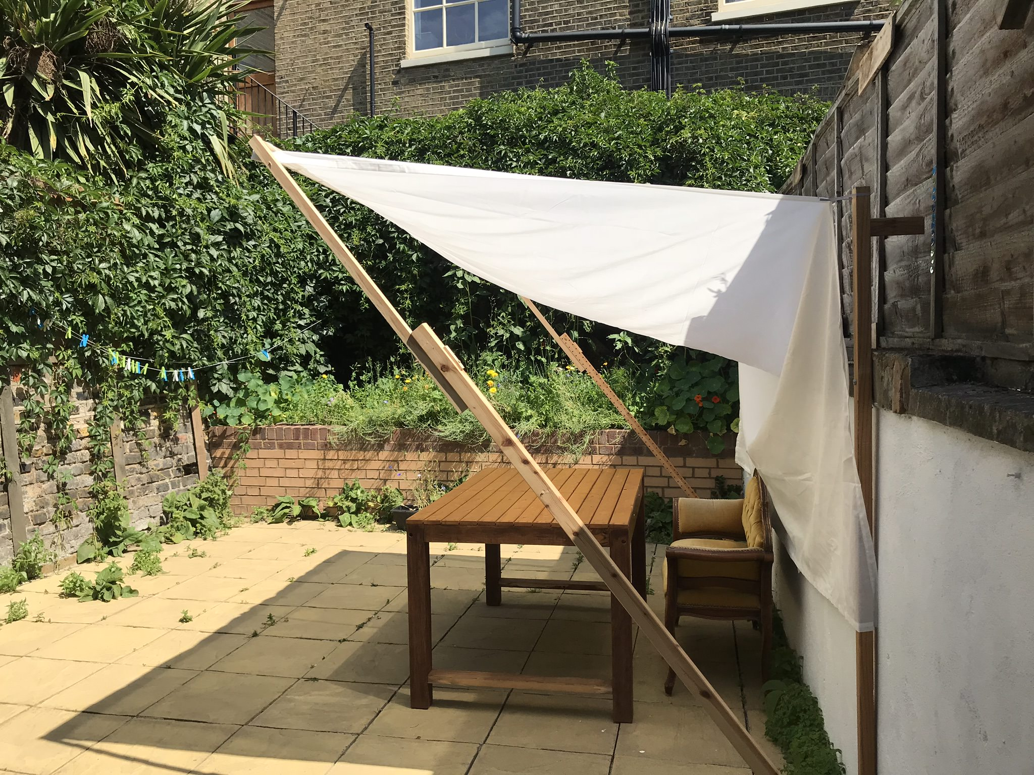 Garden view with pergola creating shadow